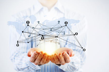 Close up of businessman demonstrating in palm network concept Banco de Imagens