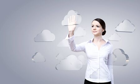 virtual technology: Attractive businesswoman touching cloud icon on screen