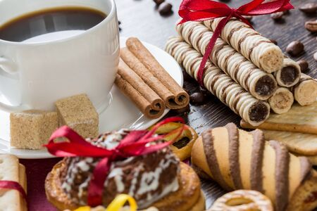 grounded: Assorted biscuits and sweets with a cup of coffee on table Stock Photo