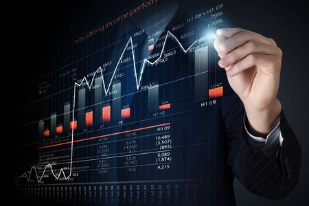 average guy: Close view of businessman drawing on screen market infographs Stock Photo