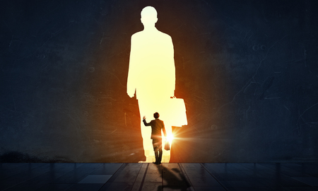 Back view of businessman standing in light representing success concept