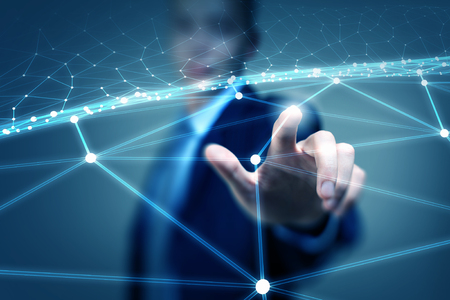 Businessman hand touching with finger digital connection lines on virtual screen Standard-Bild