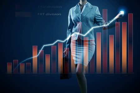 Close view of businesswoman drawing on screen market infographs