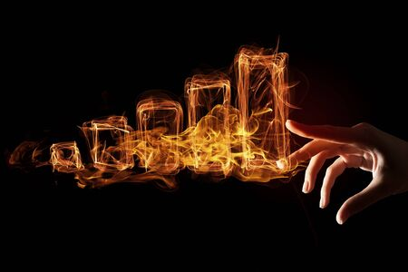 grow money: Hand touch fire glowing graph sign on dark background