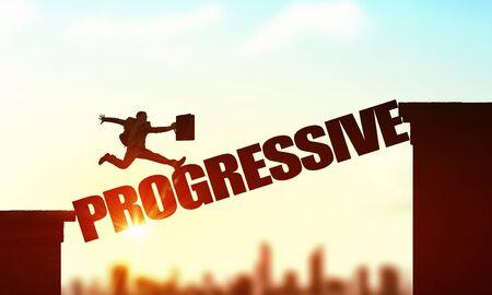 progressive: Businessman running on progressive word bridge over precipice