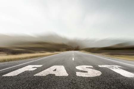 Conceptual image with word on asphalt road