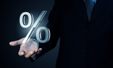 Close view of businessman holding in palm percent sign