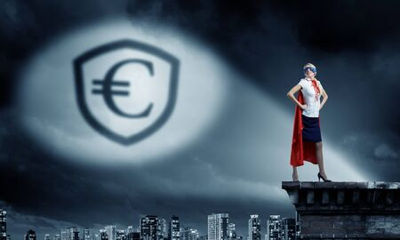 moneymaking: Young woman super hero and euro sign in spotlight