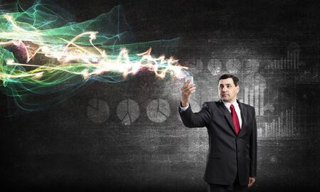 average guy: Businessman using his smartphone and glowing light out of screen Stock Photo