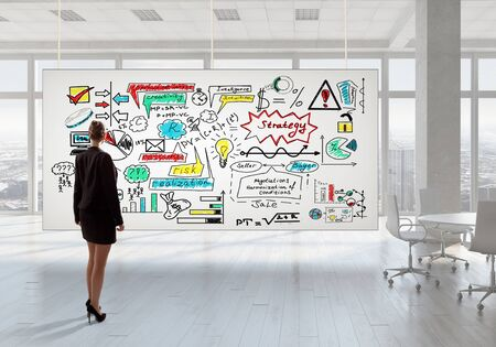 view of an elegant office: Elegant businesswoman in modern office interior against window panoramic view looking at banner