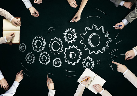 people working together: Top view of people hands drawing teamwork strategy Stock Photo