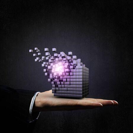 disintegrating: Businessman hand shows disintegrating cube in palm