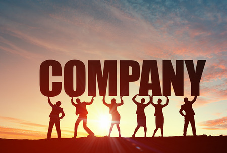 Business people lifting word company representing collaboration concept