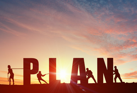 cooperation: Business people pulling word plan representing collaboration concept