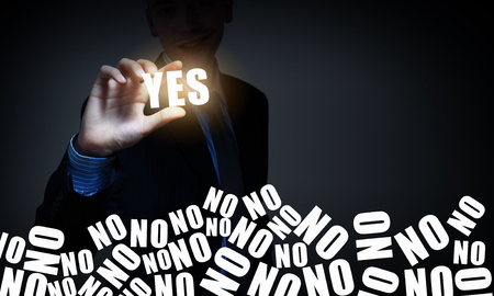 Hand of businessman taking word yes with fingers Stock Photo
