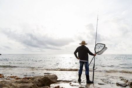 fisherman: Picture of fisherman fishing with rods