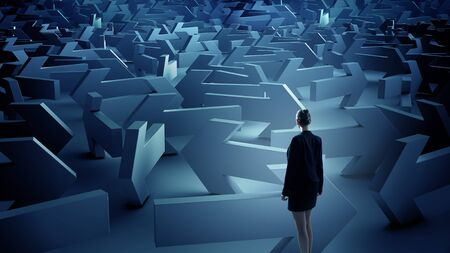 puzzled: Puzzled businesswoman in labyrinth choosing her way direction