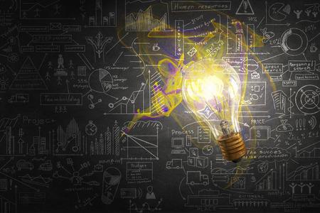 ガラスの白熱電球やビジネス アイデアをスケッチ 写真素材 - 50767461