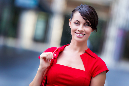 office life: Portrait of beautiful business woman in red dress