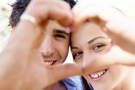 female symbol: Young couple in the park and heart symbol