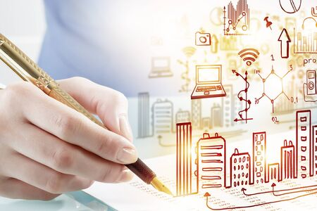 architect drawing: Close view of woman architect drawing modern construction project Stock Photo