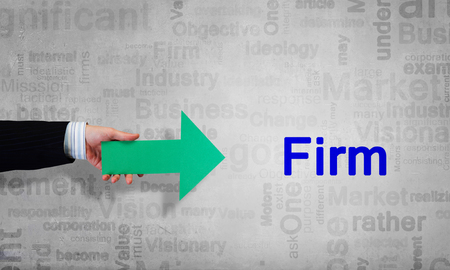 Person hand pointing with green arrow at firm word