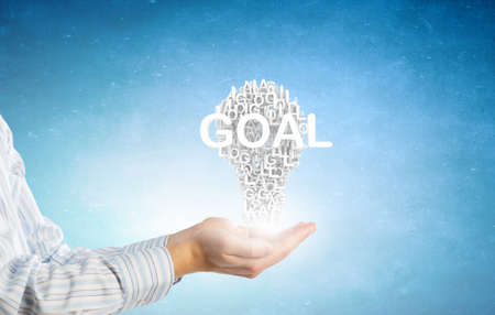 achieving: Hand of person showing successful idea for goal achieving
