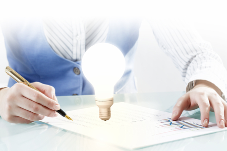 bright ideas: Close view of businesswoman writing down her bright ideas Stock Photo