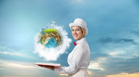 imagination: Young woman in white cylinder and red bowtie with book in hands. Elements of this image are furnished by NASA