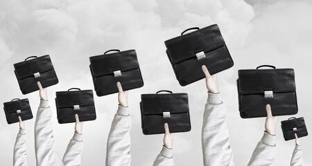 many hands: Many hands of business people holding suitcases