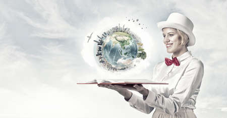 broaden: Young woman in white cylinder and red bowtie with book in hands. Elements of this image are furnished by NASA
