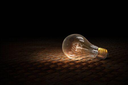 glass brick: Glass glowing light bulb on brick background Stock Photo