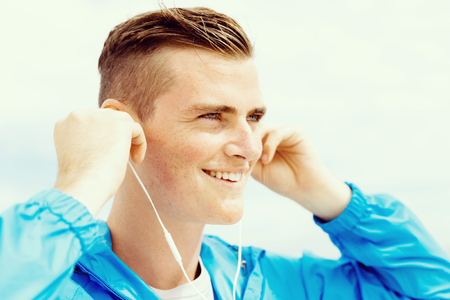 only one man: Sports and music. man getting ready for jogging and listening to the MP3 player