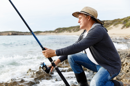 waders: Picture of fisherman fishing with rods