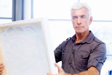 art gallery: Man standing in a gallery and contemplating abstract artwork