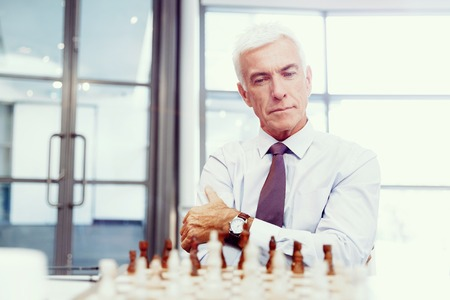 playing chess: Businessman in office playing chess