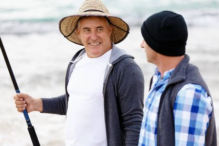 Picture of fishermen fishing with rods