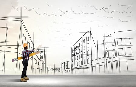 architect plans: Young female engineer in hard hat with big pencil and buildings sketches at background