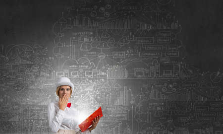 broaden: Young woman in white hat with opened red book in hands