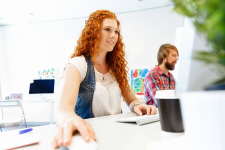 coworkers: Two co-workers working together in office Stock Photo