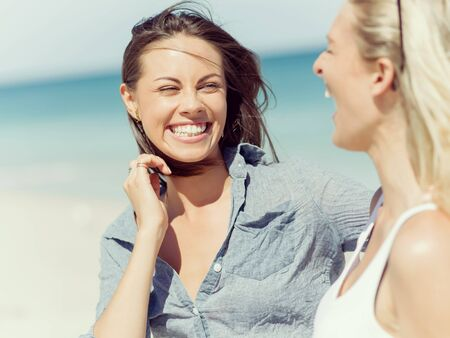 woman beach: A picture of two women having good time on beach