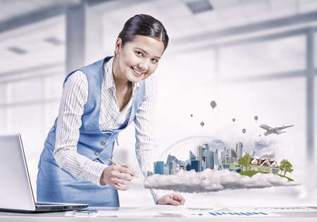 modern businesswoman: Young smiling businesswoman working with modern real estate concept
