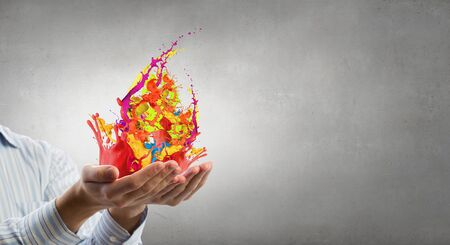 creativity: Male hands with paint splashes in palms Stock Photo