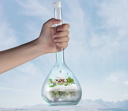 green eco: Hand holds flask with image of green life concept