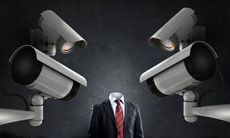 incognito: Headless businessman in room under CCTV camera control Stock Photo