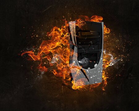 orange inferno: Concept of electronics break with device in fire flames Stock Photo
