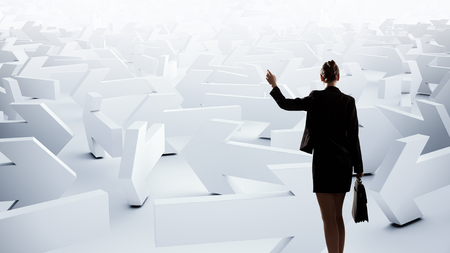 hard to find: Puzzled businesswoman in labyrinth choosing her way direction