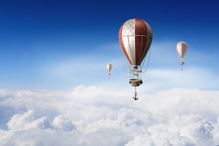 air baloon: Hot air balloon flying in cloudy day sky