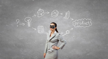 hidden success: Young thoughtful businesswoman with black mask on face Stock Photo