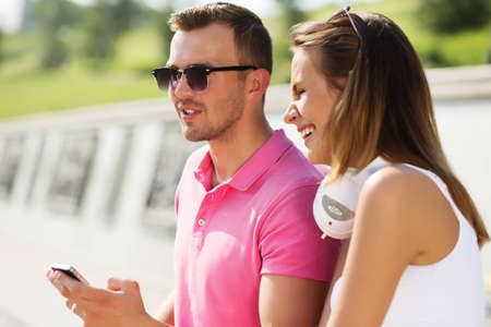 acquaintance: Young happy couple having date in summer park